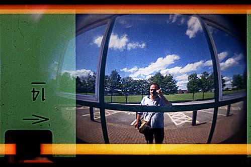 reflected self-portrait with Demekin 110 Fisheye camera by pho-Tony