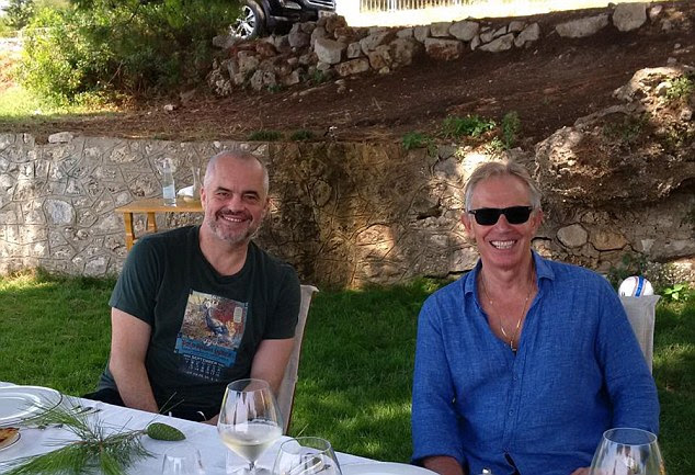 Tony Blair (right) was photographed sat next to the Prime Minister of Albania, Edi Rama