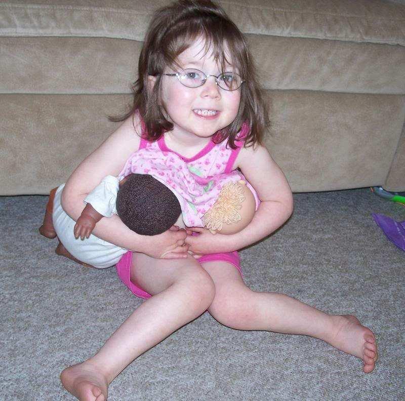 http://www.breastfeedingbasics.com/wp-content/uploads/2011/07/Little-girl-nursing-dolls.jpg