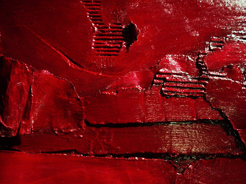 a detail of custom painting Ruby Horizon, ruby red maroon crimson acrylic on cardboard sculptural bas-relief painting assemblage acrylic on cardboard