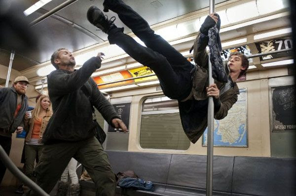 After being bitten by a genetically-altered spider, Peter Parker discovers his new powers aboard a subway train in THE AMAZING SPIDER-MAN.