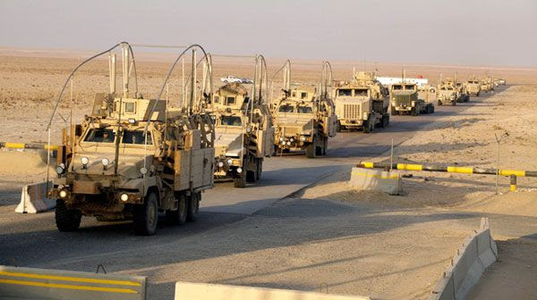 The last vehicles in a U.S. Army convoy cross the border from Iraq into Kuwait, on December 18, 2011.