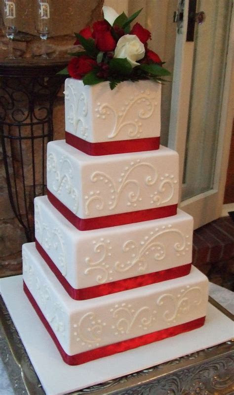 Wedding cake with red ribbon