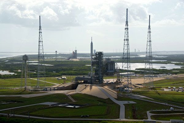 The present and the future (hopefully)...both poised for launch at Kennedy Space Center in Florida.