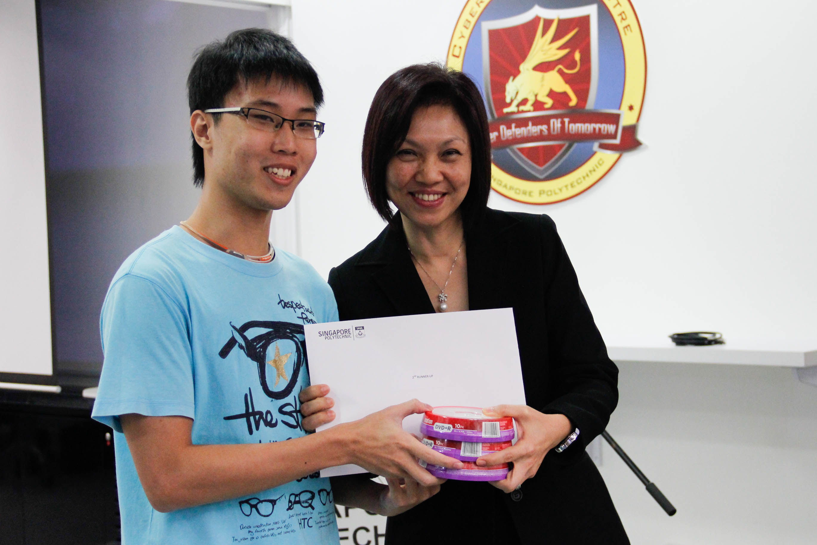 DMIT Director Ms Georgina Phua presenting Certificate of Merit to DISM CTF S1 2nd Runner-up team Digimon