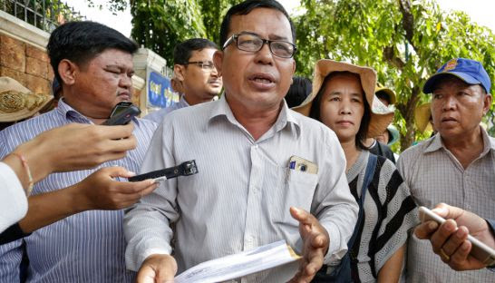 Kao Sovann, deputy leader of a Phnom Penh airport community, talks to the media yesterday outside the ACU headquarters.