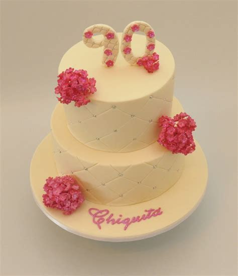 90 birthday cake in yellow with pink floral cake decor.PNG