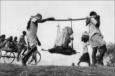 File:Two-men-carrying-woman1947.jpg