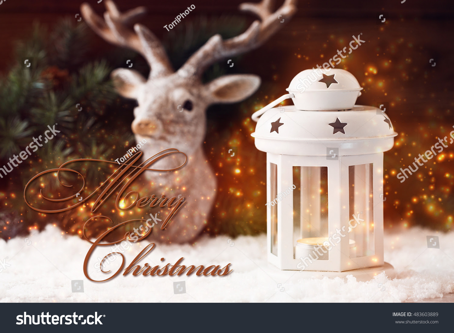 http://www.shutterstock.com/pic-483603889/stock-photo-merry-christmas-card-with-white-lantern-shine-lights-and-deer-decoration-on-background-shallow-focus.html