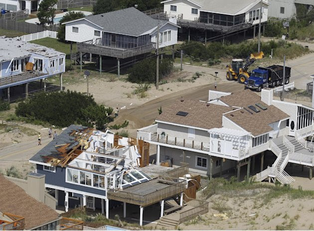 A house damaged by Hurricane Irene is seen in Virginia Beach, Va., Sunday, Aug. 28, 2011.  From North Carolina to New Jersey, Hurricane Irene appeared to have fallen short of the doomsday predictions,