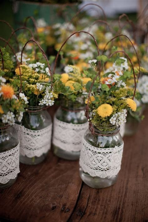 Our lace wrapped hanging mason jars. Gorgeous.   Yelp