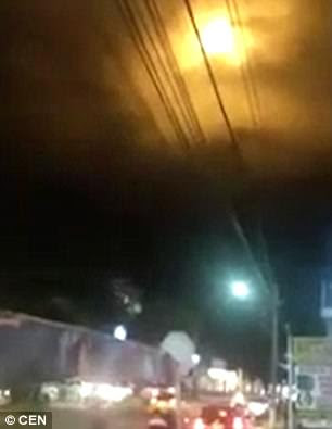 Footage captured by residents in Colombia shows a large ball of light looming overhead for several minutes
