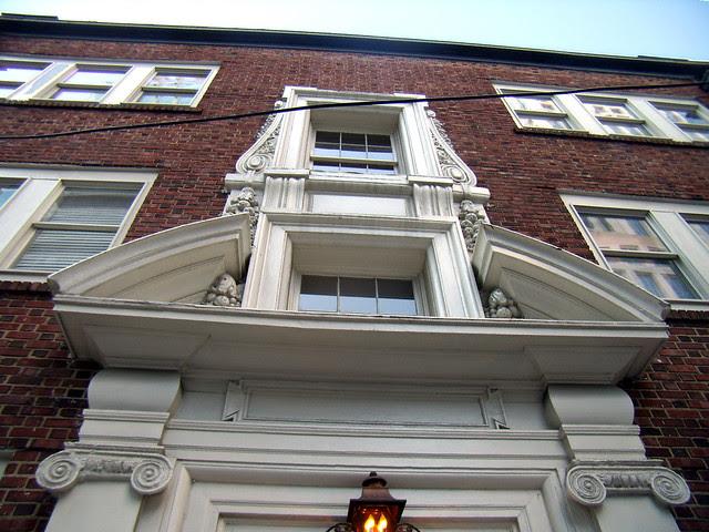 P2082049-Phelan-Apartments-Entrance-Detail-Fruit-Scroll-Butress-Detail-Looking-Up