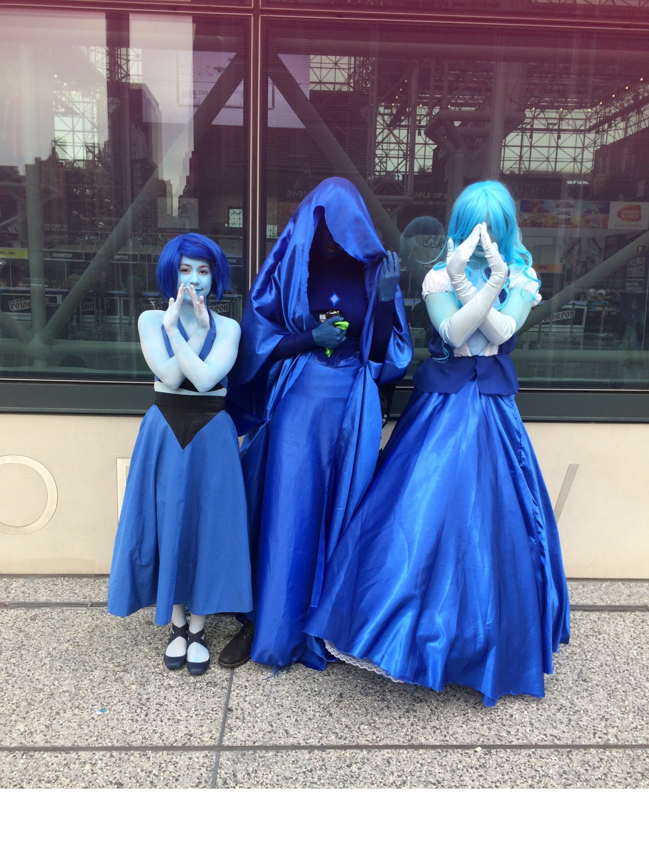 in honor of the first year anniversary of the Answer, this is my cosplay from last year's NYCC as Sapphire from the Answer with lapis and Blue Diamond all together as Blue Diamond's court