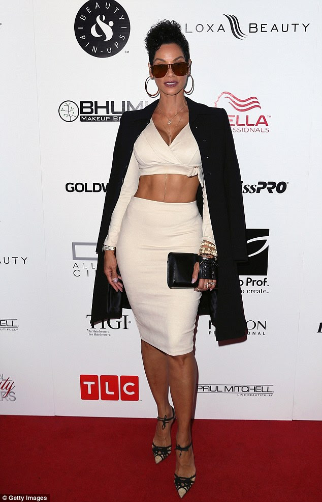 White hot:Nicole Murphy wowed in an all-white look at a preview party for TLC's Global Beauty Masters Season 2 in West Hollywood, California, on Wednesday night