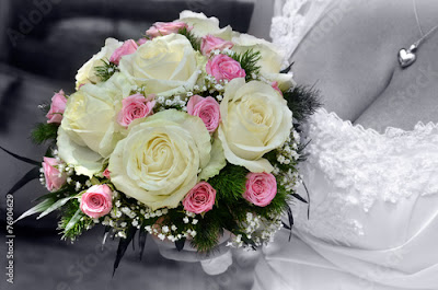 Bride wedding flowers bouquet with roses and green leaves