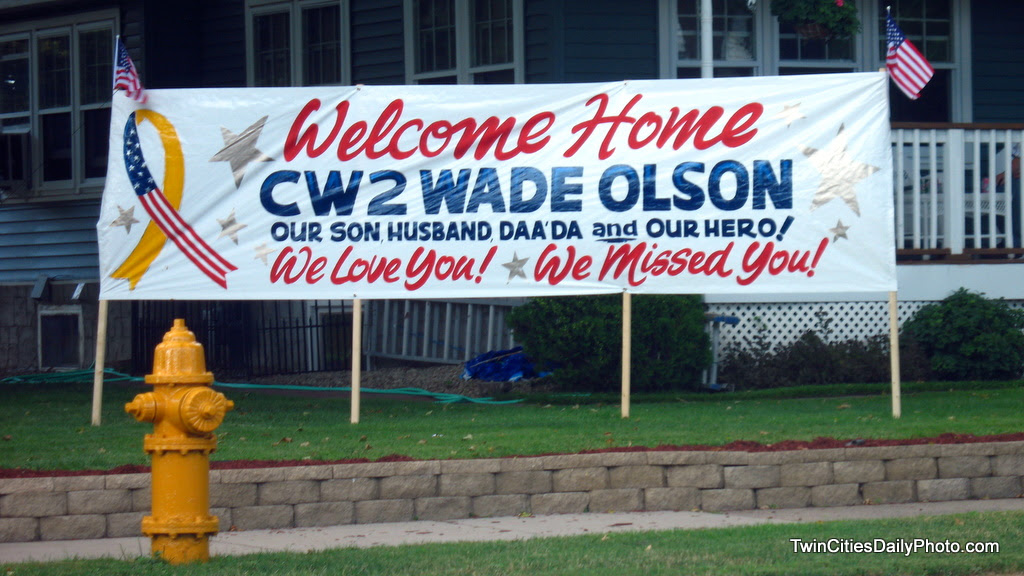 A sign welcoming home a soldier from the war.