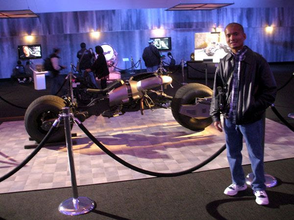 Posing with the Batpod from THE DARK KNIGHT and THE DARK KNIGHT RISES, on December 7, 2012.