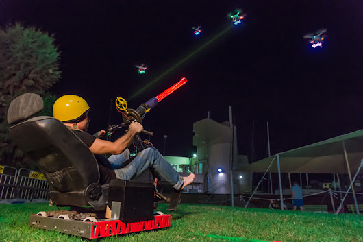 A Real Life Version of Space Invaders Made Using Drones, a Motorized Chair, and a Giant Laser