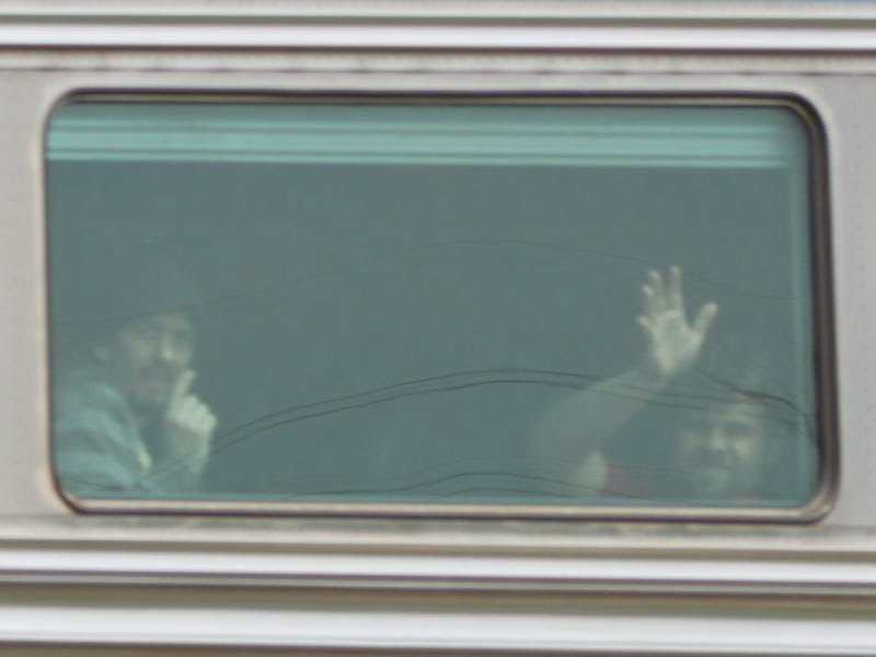 Passengers waving on a train