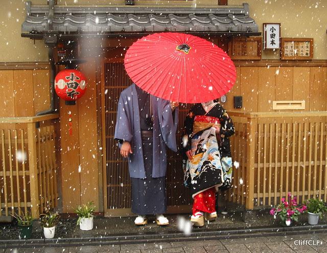 Beneath the red umbrella...