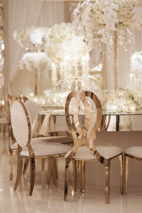 Glamorous Gold Wedding Chairs and Mirror Tables at Four