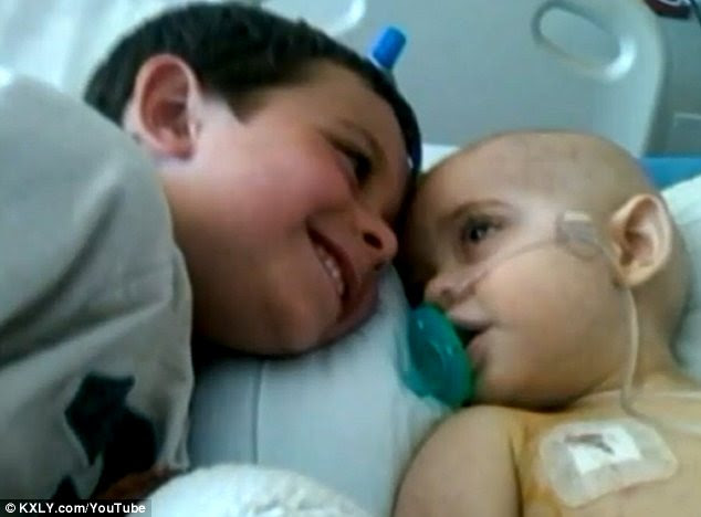 The youngster with his older brother Colty as he is treated in hospital.