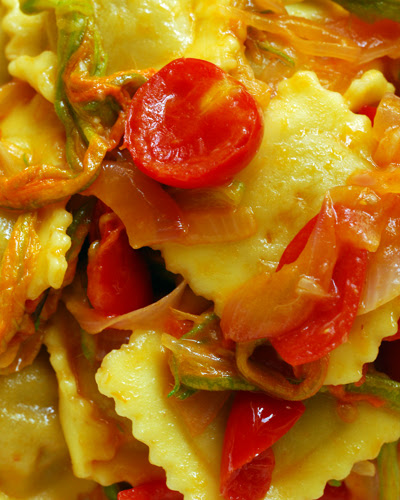 ravioli with cherry tomatoes and zucchini flowers