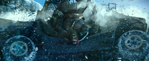 Raphael (Alan Ritchson) collides shell-first into a Humvee in TEENAGE MUTANT NINJA TURTLES.