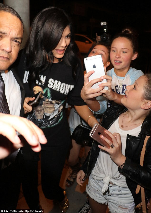 Calm down: The fan looked distressed as Kylie headed into the restaurant without stopping for photos