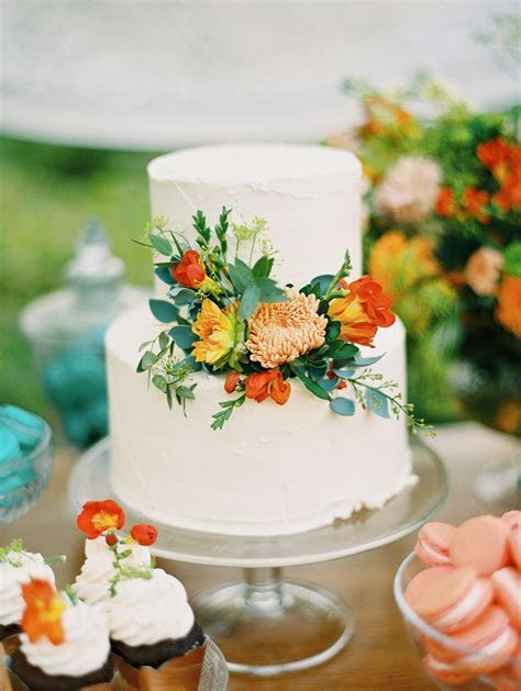 Simple white cake decorated with fresh flowers from the
