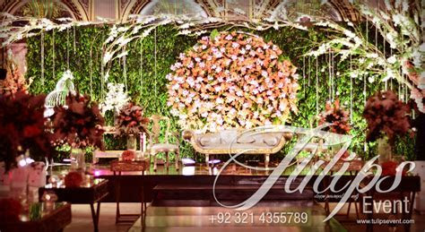 green garden wedding theme stage setup design in Pakistan