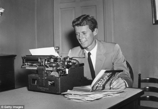 Studies: The future American president sits at a typewriter, holding open his published thesis, 'Why England Slept'