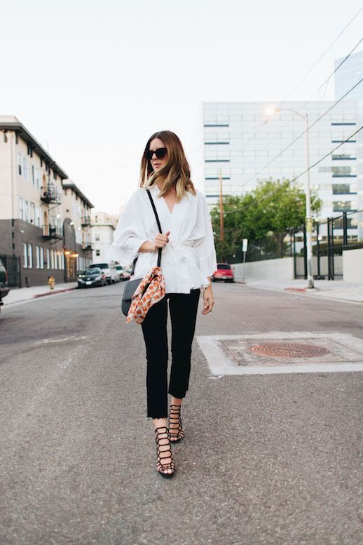 Le Fashion Blog Kimono Wrap Top Black Raw Hem Jeans Schutz Black Sandals Via Take Aim