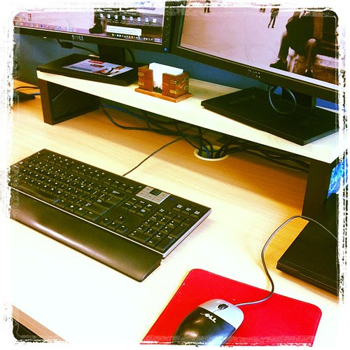 Yay. Liking my new dual monitor stand. #ikea shelf with 2 photo frames for legs.  $27, more desk space priceless