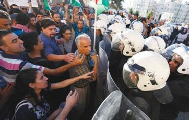 PALESTINIAN RIOT police face civilians protesting security coordination between the PA and Israel in