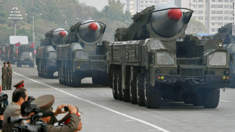 Trucks transport what appear to be North Korea's Musudan intermediate-range ballistic missiles at a military parade in Pyongyang on October 10, 2010.