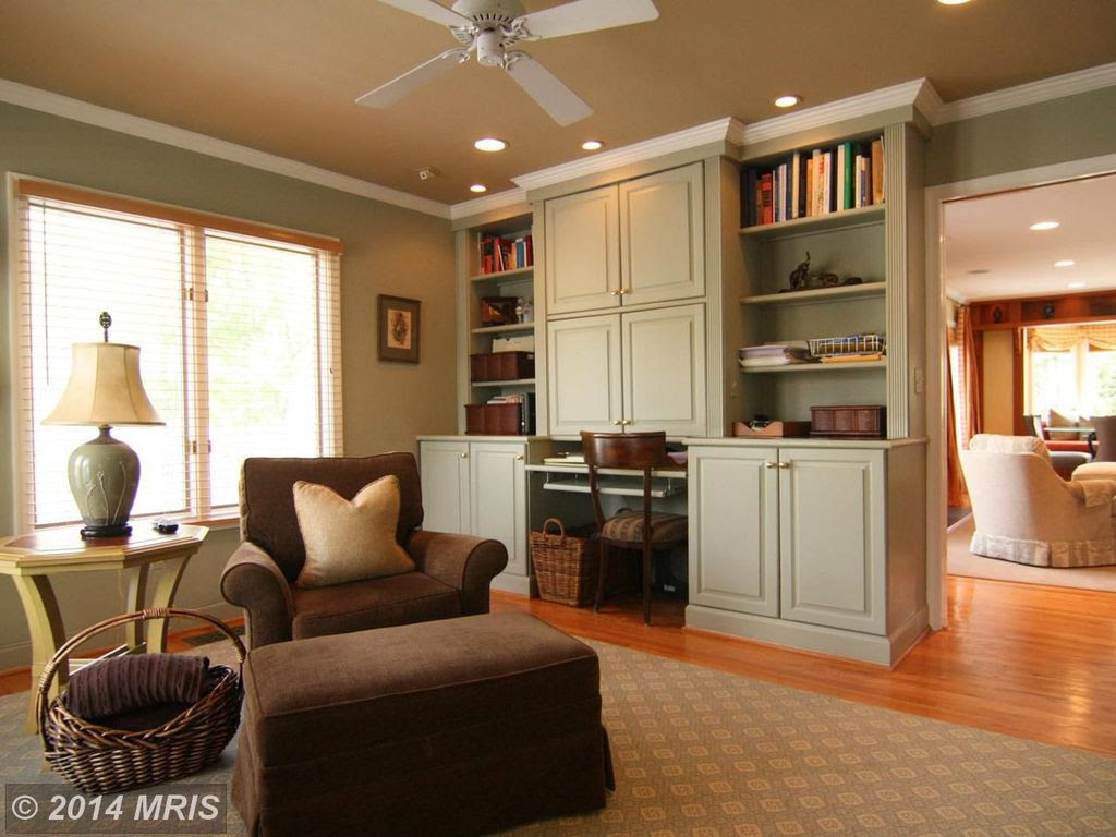 Traditional Home Office with Crown molding, Ceiling fan, Hardwood floors, Built-in bookshelf