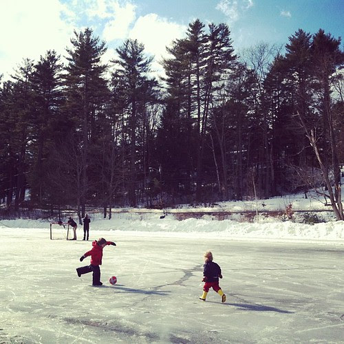 Playing soccer on the ice.