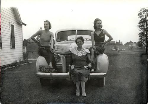three women on a car
