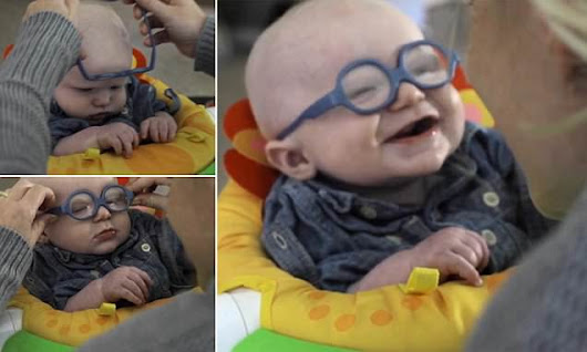 Baby smiles in delight at seeing his mother for the first time