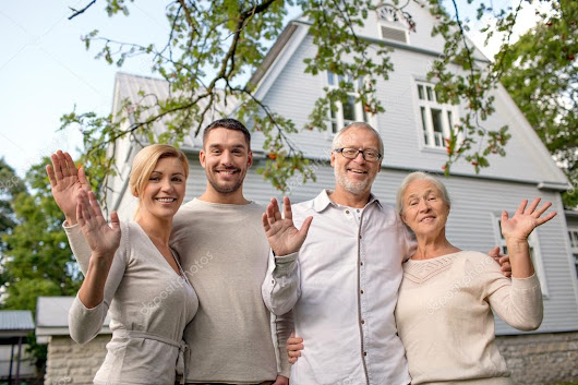 happy family in front of house outdoors — Stock Photo © Syda_Productions #54348451