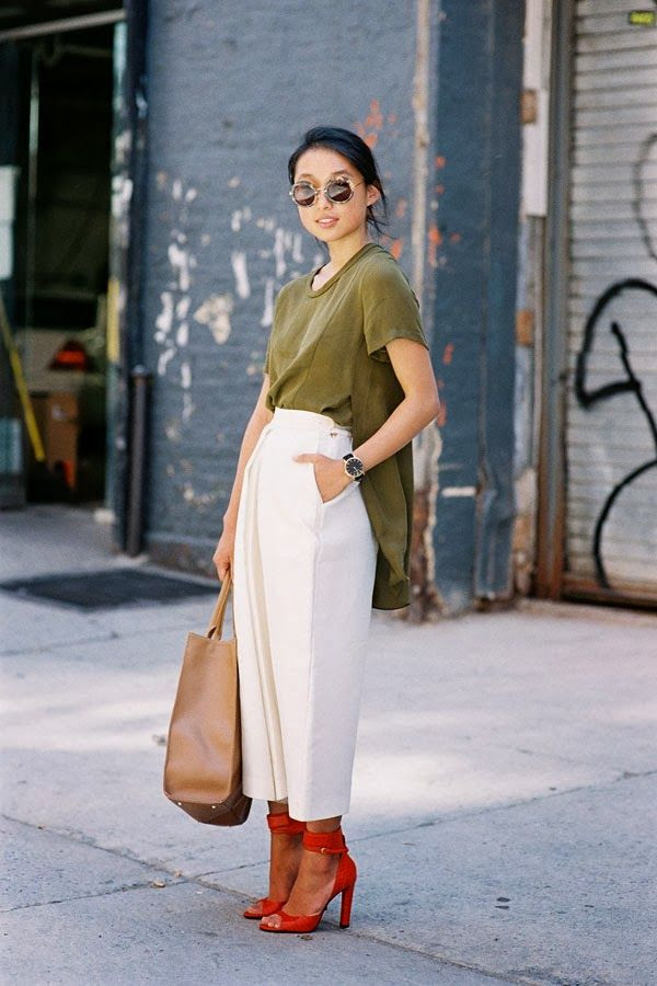 Le Fashion Blog New York Fashion Week Street Style Margaret Zhang Shine By Three Complementary Colors And Cutlottes Via Vanessa Jackman Side Shot Round Tort Sunglasses Low Bun Chignon Hair Olive Green Side Split Shirt Tan Leather Tote Bag High Waisted Off White Culottes Cropped Wide Leg Pants Trousers Bright Red Ankle Wrap Heeled Sandals Heels 1 photo Le-Fashion-Blog-New-York-Fashion-Street-Style-Margaret-Zhang-Shine-By-Three-Complementary-Colors-And-Cutlottes-Via-Vanessa-Jackman-1.jpg