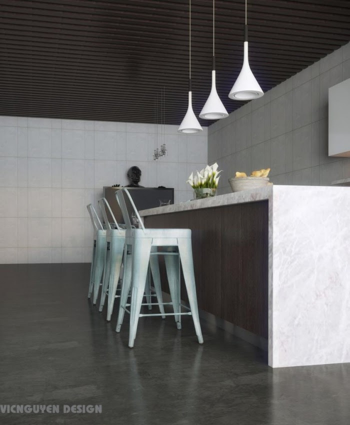 An open plan modern home features a full size kitchen with bar island that opens