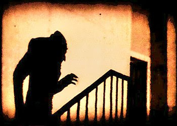 A screenshot of the 1922 film, Nosferatu. Thou...