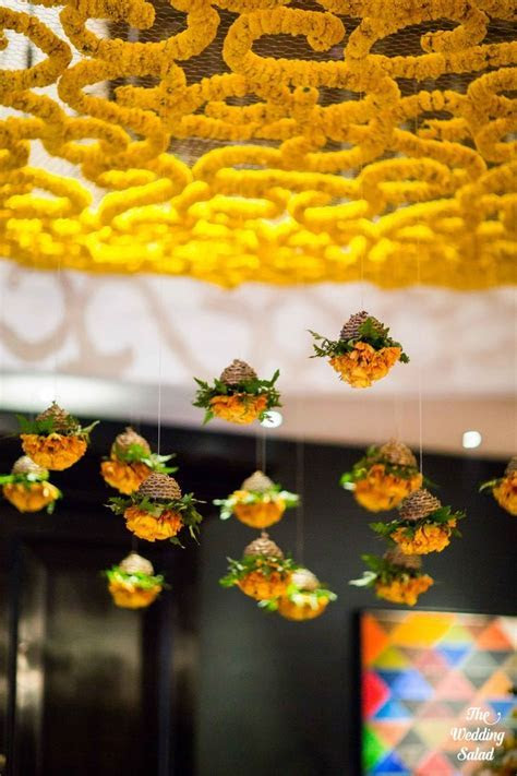 Floral hanging ceiling arrangements with suspended genda