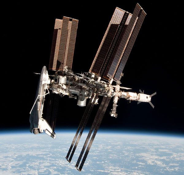The International Space Station (ISS) with space shuttle Endeavour docked to it, as seen from a Russian Soyuz vehicle after it undocked from the ISS on May 23, 2011.