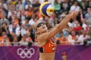 Sophie van Gestel of the Netherlands returns a shot during their women's preliminary round beach volleyball match against Australia at the London 2012 Olympic Games at Horse Guards Parade
