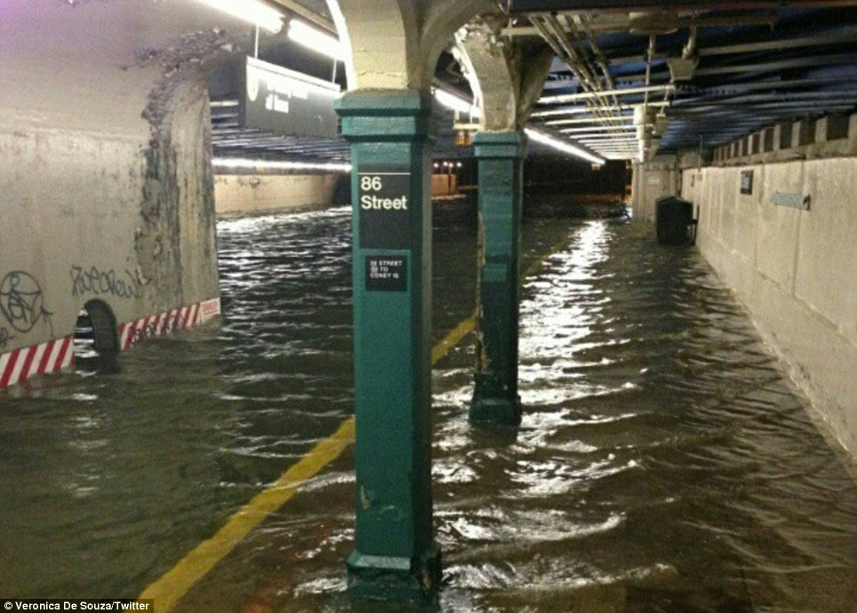 No train service: Veronica De Souza posted this extraordinary picture ('via ninjapito') on Twitter of the 86th Street station with water above the platform