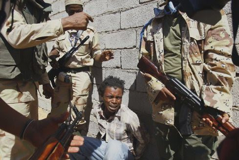 Africans being tortured by the CIA-trained rebels now roaming the North African state of Libya. The rebels were suppoted and installed by the imperialist states. by Pan-African News Wire File Photos